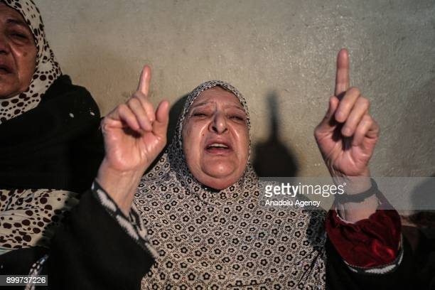 A woman cries during the funeral ceremony of 20yearold Cemal Mohamed Maslah who was wounded on the clashes between Palestinian protesters and Israeli...
