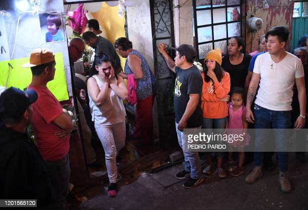 A woman cries during the funeral of a sevenyearold girl whose body was found over the weekend with signs of torture in the municipality of Tlahuac in...