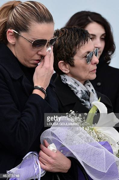 A Woman Cries During The Funeral Of Greek Singer Demis -9117