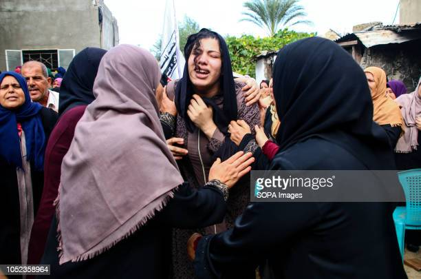 A woman cries during the funeral of martyr Naji Jamal alZa'anin Naji Jamal alZa'anin 25 years old was killed by an Israeli airstrike in the Gaza Strip