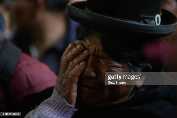 A woman cries during the funeral of people killed yesterday during clashes between supporters of Evo Morales and security forces in the entrance of a...