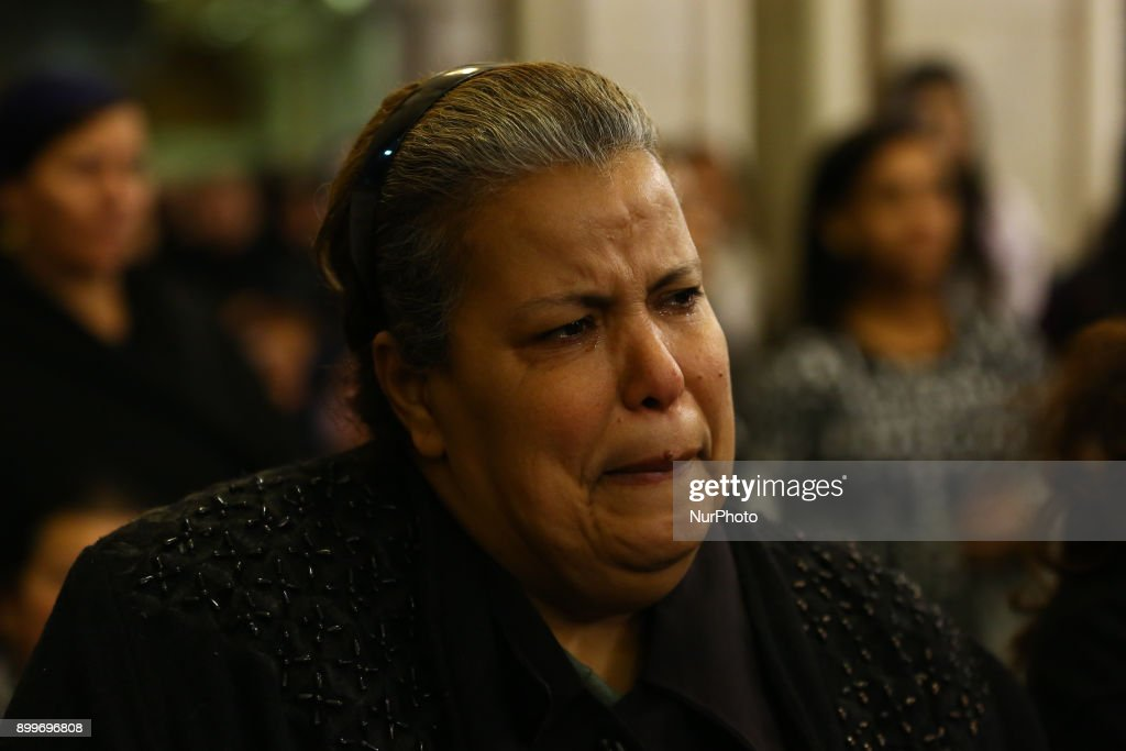 A woman cries during the funeral service of the victims of Egypt's Mar Mina church attack at a church in Helwan, South-eastern Cairo, Egypt, 29 December 2017. At least ten people were killed Friday when a terrorist attack on the Marminna church was foiled in Helwan, south of Cairo.