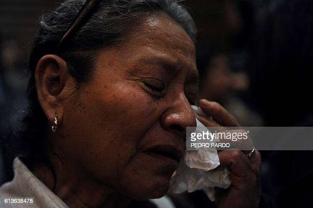 A woman cries during the presentation of the independent inquiry into the massacre of 72 migrants in San Fernando Tamaulipas in August 2010 and the...