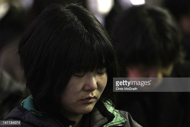 A woman cries during the Rikuzentakata City tsunami ceremony on March 11 2012 in Rikuzentakata Japan On the one year anniversary the areas most...