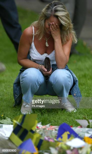 A woman cries in front of floral tributes before a special service for the missing ten year old schoolgirls Jessica Chapman and Holly Wells at St...