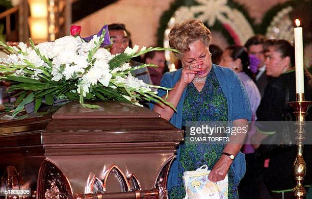 A woman cries next to the casket containing the remains 22 April 1993 of the late actor/comedian Mario Moreno known to moviegoers as Cantinflas...
