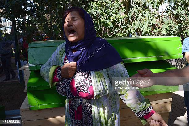 A woman cries next to the coffin of a victim on July 20 2015 after an explosion in the town of Suruc not far from the Syrian border At least 30...