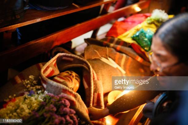 A woman cries next to the corpse of one of the men killed yesterday during clashes between supporters of Evo Morales and security forces in the...