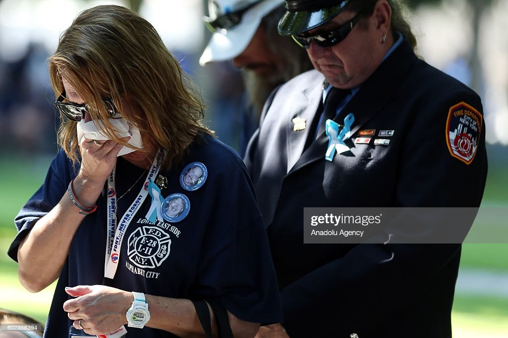 A woman cries on the 15th anniversary of the 9/11 in Ground Zero, Manhattan, New York, United States on September 11, 2016.