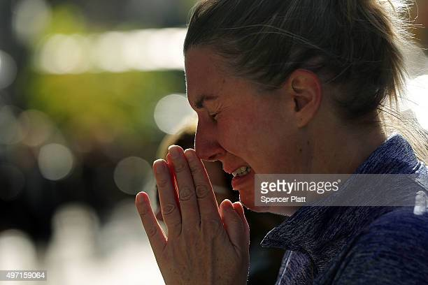 A woman cries outside of the Consulate General of France in New York the day after an attack on civilians in Paris on November 14 2015 in New York...