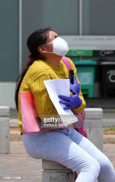 A woman cries outside the Guasmo Sur hospital in Guayaquil Ecuador on April 4 2020 during the novel coronavirus COVID19 pandemic Ecuador's vice...