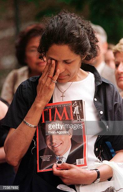 A woman cries while attending the public memorial mass for John F Kennedy Jr Carolyn Bessette Kennedy and Lauren Bessette July 22 1999 at St...