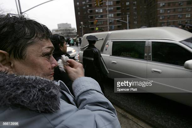 A woman cries while looking at the hearse carrying the body of Nixzmary Brown after her funeral January 18 2006 in New York City Brown was found...