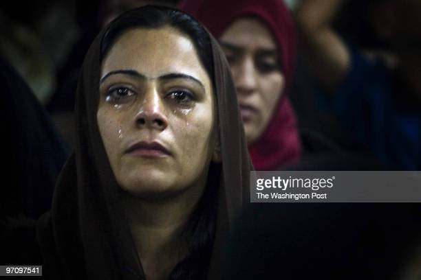 A woman cries while waiting to see her husband an Iraqi detainee during their visitation hour at Camp Bucca Camp Bucca is a holding facility for...