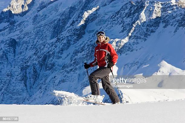 Woman cross country skiing on mountain