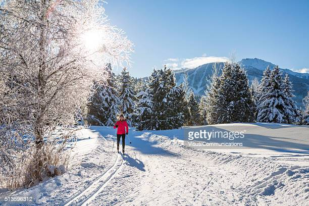 woman cross country skiing on sunny day. - winter sport stock pictures, royalty-free photos & images