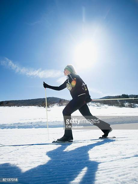 woman cross country skiing - nordic skiing event stock pictures, royalty-free photos & images