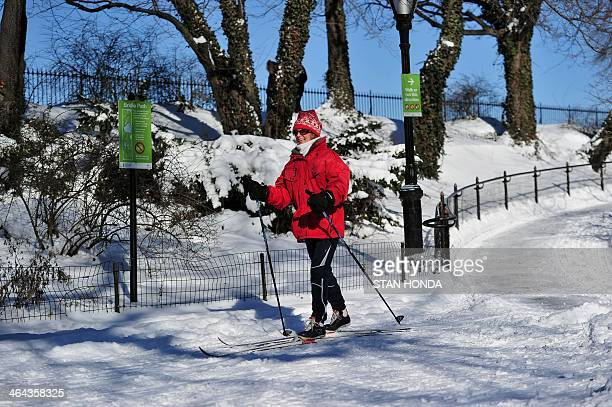 A woman cross country skis through Central Park in frigid temperatures January 22 2014 in New York The northeastern US shivered amid heavy snowfall...
