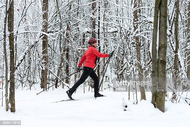 Woman cross-country skiing, snow, winter sport.