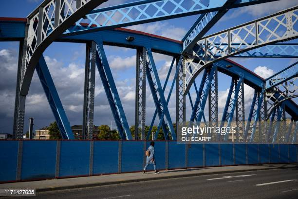 A woman crosses a bridge over a railway line in Peterborough city centre central England on September 26 2019 Most of us in Peterborough know...