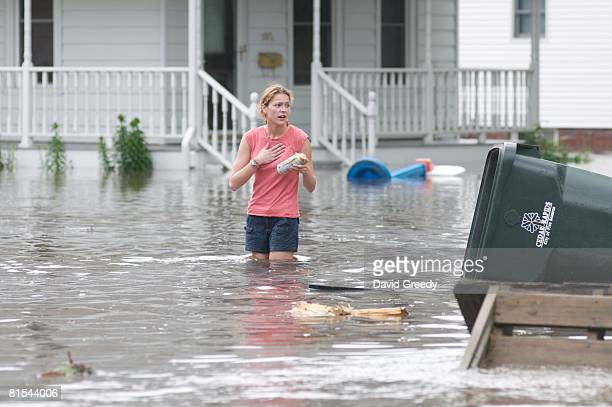 Woman crosses a flooded street to check on her evacuated home on June 12, 2008 in Cedar Rapids, Iowa. Much of the city has been evacuated as the...