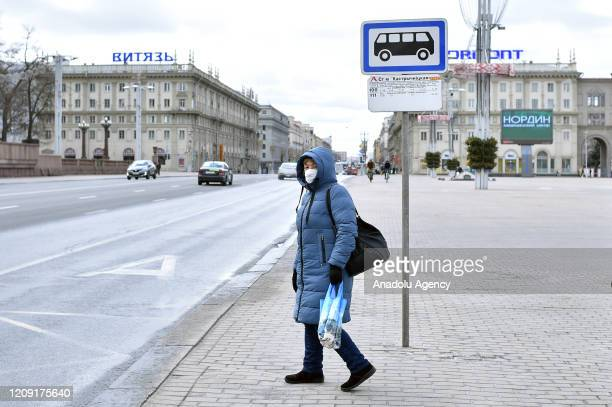 A woman crosses a street amid coronavirus pandemic precautions in Minsk Belarus on April 05 2020 Death toll rises to 8 in Belarus due to the Covid19