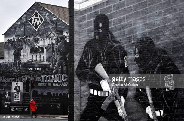 A woman crosses the street against the backdrop of the John Stewart painted mural dedicated to the men women and children who lost their lives on the...