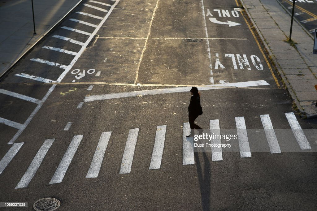 A woman crossing a street in Dumbo, Brooklyn, New York City, USA : Stock Photo
