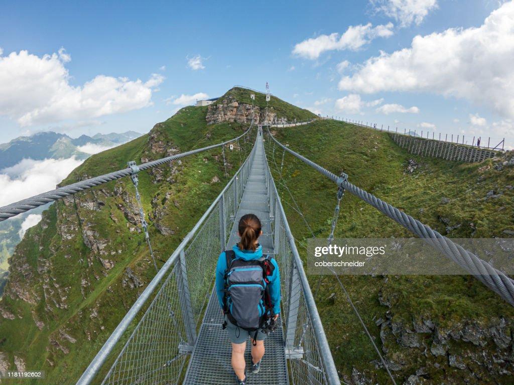 Woman Crossing A Suspension Bridge Austrian Alps Bad Gastein ...