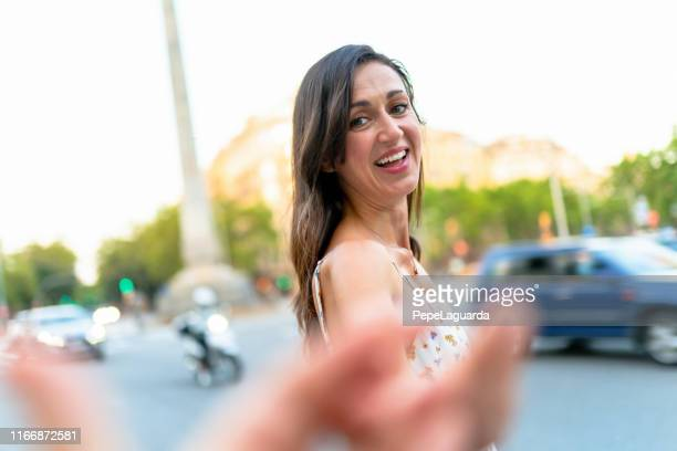 Woman crossing street in Barcelona at Passeig de Gràcia