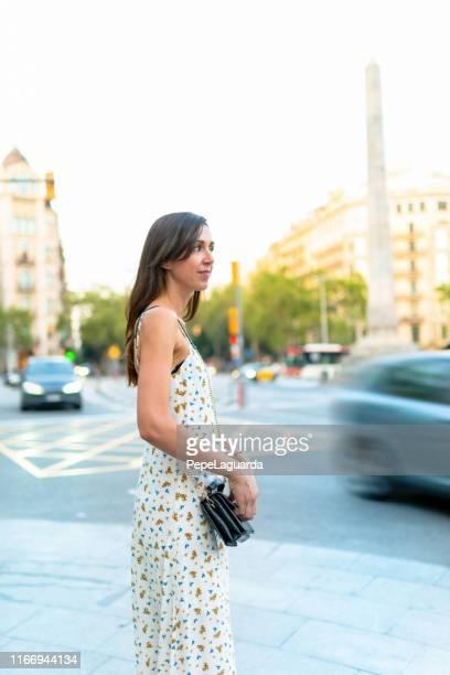 Woman crossing the street in Barcelona