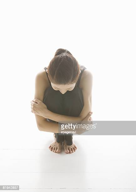 Woman crouching down