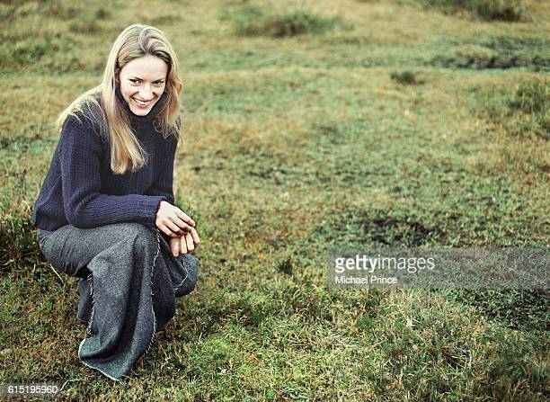 Woman Crouching on Grass