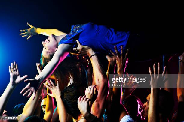 woman crowd surfing - prop stock pictures, royalty-free photos & images