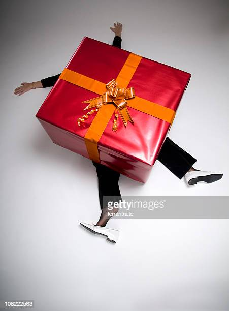 Woman Crushed Beneath Huge Wrapped Present