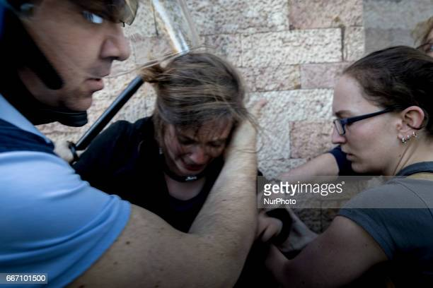 A woman cry during a in Lucca Italy on April 10 2017 during a demonstration against G7 Foreign Minister Meeting in Lucca on April 1011 2017