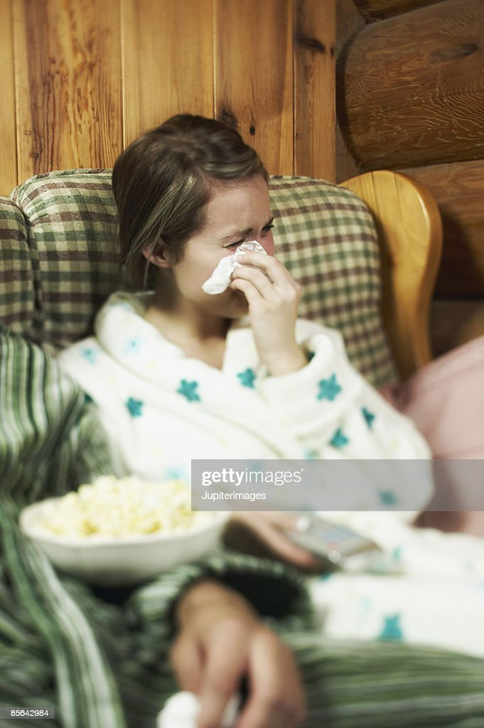 Woman crying and watching tv : Stock Photo