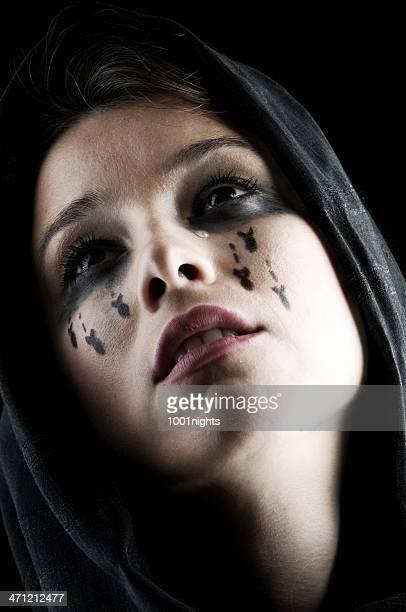 Woman crying bombs