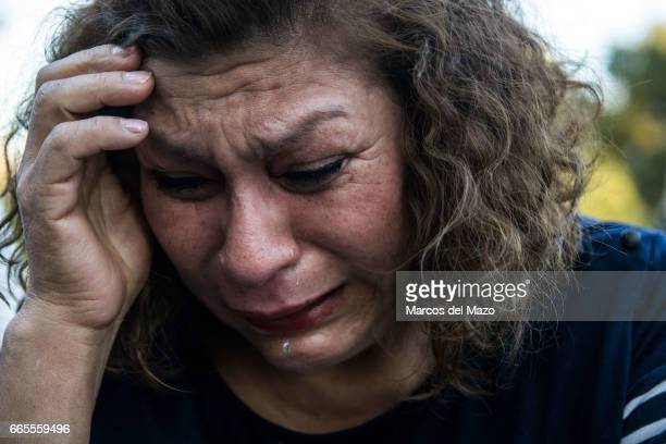 A woman crying during an event organized through Facebook under the name 'Gathering for crying' celebrated in the Retiro Park