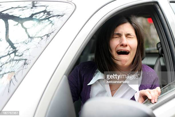 Woman crying in a traffic jam