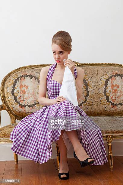 Woman crying on ornate couch