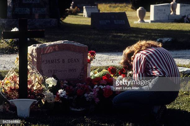 A woman crying over the grave of James Dean on the 30th anniversary of the young star's death