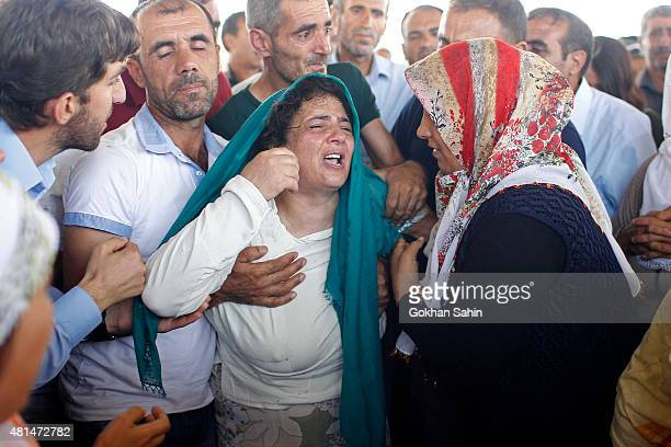 A woman crys during a funeral ceremony for the victims of a suicide bomb attack yesterday which killed 32 people in the southern Turkish town of...