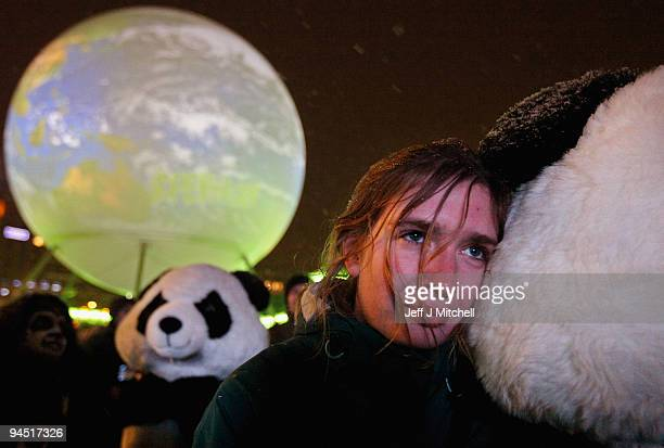 A woman cuddles a protestor dressed as panda at an evening demonstration on December 16 2009 in Copenhagen Denmark Hundreds of climate demonstrators...