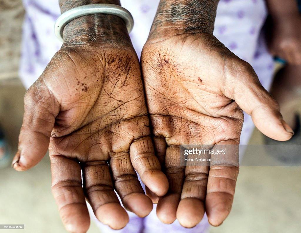 Woman cupping palms, close-up : Stock Photo