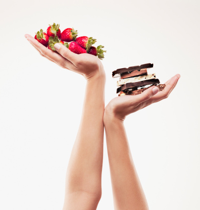 Woman cupping strawberries above chocolate bars - gettyimageskorea