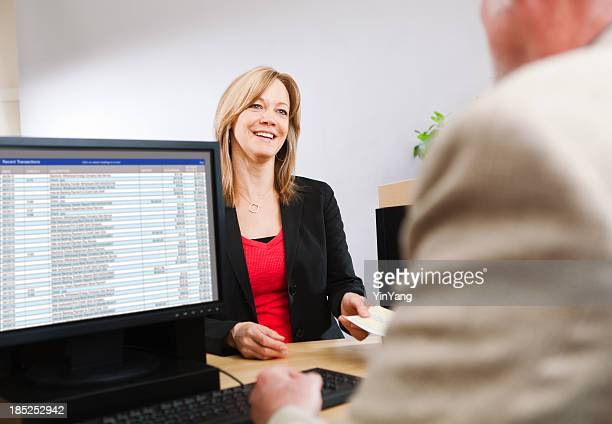 Woman Customer Visiting Retail Banking Counter with Bank Teller Hz