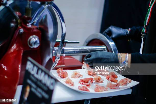 A woman cuts ham during The Summer Fancy Food Show at the Javits Center in the borough of Manhattan on July 02 2018 in New York The Summer Fancy Food...