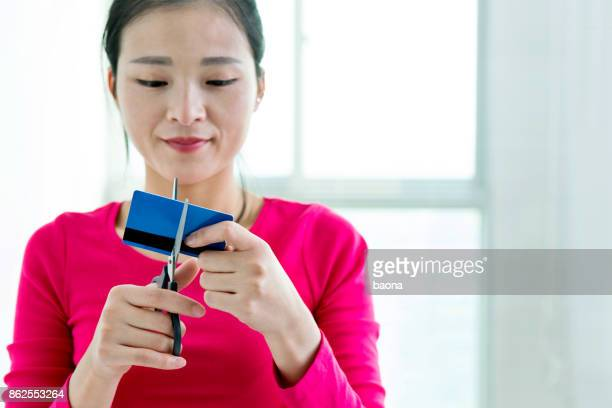 woman cutting a credit card - cross section stock pictures, royalty-free photos & images