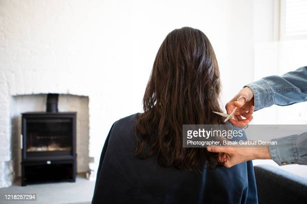 a woman cutting a woman's hair - domestic life stock pictures, royalty-free photos & images
